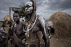 Mursi tribeswomen and children, with stretched lips and other adornments. Omo Delta, Ethiopia, Africa.
