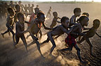Dassenech children at playing in the late afternoon light, Omo Delta, Ethiopia, Africa.