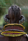 Rear view of an Turkana tribewoman, with multiple earrings and elaborate bead collar, Lake Turkana, Northern Kenya, Africa.