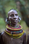 Turkana tribewoman, with multiple earrings and elaborate bead collar, Lake Turkana, Northern Kenya, Africa.