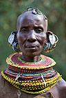 Turkana tribeswoman, with multiple earrings and elaborate bead collar, Lake Turkana, Northern Kenya, Africa.