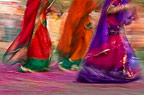 Women walking on coloured paper at Elephant festival, Jaipur.