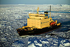 Icebreaker churning through ice floes, Antarctica