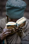 Old man reading a holy book, Lalibela, Ethiopia, Africa.