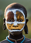 Suri girl with clay painted face, Omo Delta, Ethiopia