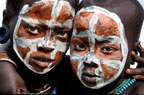 Suri children with painted faces, Omo Delta, Ethiopia