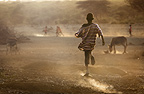 Boy running to join football game, Afar tribe, Bilen, Ethiopia.