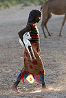 Girl of the Afar tribe carrying a young goat, Bilen, Ethiopia