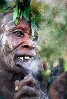 Suri tribeswoman with lip stretched for lip plate, smoking,  Omo Delta, Ethiopia