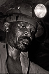Gold miner working deep underground, near Johannesburg, South Africa
