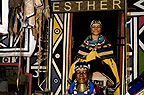 Ndebele artist, Esther Mahlangu, standing beneath a photograph of herself, South Africa.