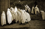 Pilgrims praying near the sunken churches of Lalibela, Ethiopia