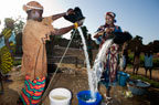 Women collecting water from a well near Djenne, Mali