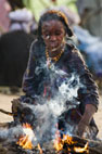 Wodaabe girl tending a fire at the Gerewol Festival, north of Abalak, Niger