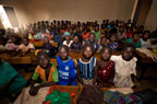 Village school classroom full of children, Dogon Country, Mali