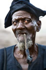 Dogon man smoking a pipe, Dogon Country, Mali
