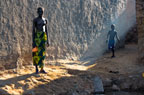 Girl and boy in a village on an island in the River Niger, near Mopti, Mali