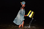 Woman collecting water in the River Niger, Mopti, Mali