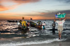 Fishermen with their early morning catch, Yoff, Dakar, Senegal, west Africa
