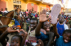 Children taking part in a street parade, St. Louis, Senegal, West Africa