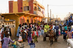Crowds watching a street parade, St. Louis, Senegal, West Africa