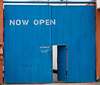 'Now Open' sign on corrugated iron doors, Nairobi, Kenya.