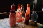 Tomato ketchup and vinegar bottles in fish and chips shop, Nairobi, Kenya.