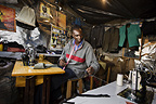 Jared Duma working in the Hope Tailoring Shop, Nairobi, Kenya.