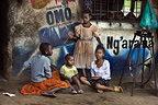 Children sitting on the side of the street, Nairobi, Kenya.
