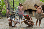 Dani tribespeople making fire in their traditional village, New Guinea, Indonesia.