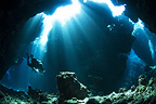 Diver in underwater cave, Red Sea, Egypt