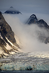 Mountain landscape with glacier, low sun and fog, N-W Svalbard, Norway