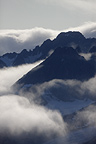 Mountain landscape with glacier and rising fog, Monaco glacier, N-W Svalbard, Norway