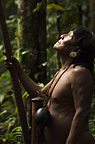 Huaorani Indian, Menga Darita, hunting in the forest with his blowgun. Gabaro Community, Yasuni National Park, Amazon rainforest, Ecuador, South America.