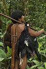 Huaorani Indian, Oña Yate, with monkeys and birds he has hunted with his blowgun. Gabaro Community, Yasuni National Park, Amazon rainforest, Ecuador, South America.