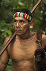 Huaorani Indian, Tage Kaiga, carrying  a woolly monkey he has shot using his blowgun. Gabaro Community, Yasuni National Park, Amazon rainforest, Ecuador, South America.