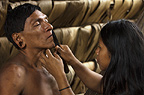 Huaorani Indian,Tage Kaiga, being shaved by his daughter. Gabaro Community, Yasuni National Park, Amazon rainforest, Ecuador, South America.