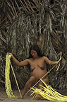 Huaorani Indian woman working with chambira, a fibre extracted from a palm leaf and used for shigras (string bags) and hammocks. Gabaro Community, Yasuni National Park, Amazon rainforest, Ecuador, South America.