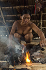 Huaorani Indian woman, Ware Baiwa, cooking a woolly monkey. Gabaro Community, Yasuni National Park, Amazon rainforest, Ecuador, South America.