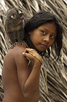 Huaorani Indian girl with her pet night monkey. Gabaro Community, Yasuni National Park, Amazon rainforest, Ecuador, South America.