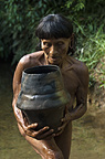 Huaorani Indian woman using clay pot for carrying water from the river. Gabaro Community, Yasuni National Park, Amazon rainforest, Ecuador, South America.
