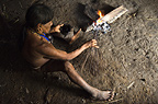 Huaorani Indian man making poisonous Curare tipped darts. Bameno Community, Yasuni National Park, Amazon rainforest, Ecuador, South America.