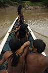 Huaorani Indians in motor canoe. Bameno Community, Yasuni National Park, Amazon rainforest, Ecuador, South America.
