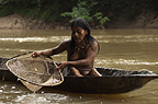 Huaorani Indian woman fishing with home made net made from chambira palm fibres. Bameno Community, Yasuni National Park, Amazon rainforest, Ecuador, South America.