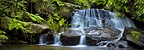 Sacred waterfall and pool in montane rain forest. Andasibe-Mantadia NP, Madagascar. Stitched panorama.
