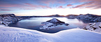 Panorama of Crater Lake in the morning, under a blanket of fresh snow, Oregon, USA