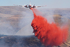 A tanker drops its load of fire retardant on the Brown Road fire in Northern Oregon, 2011