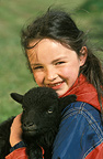 Ouessant breed lamb and young girl, France