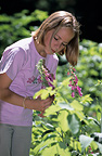 Young girl looking at a Purple Foxglove