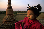 Young girl at the top of a temple of Bagan Myanmar, Burma